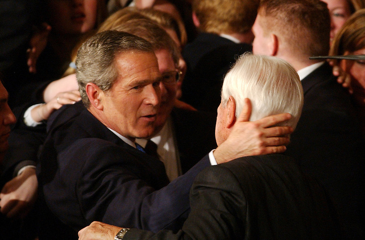 union23/012803 -- President George W. Bush says goodbyes to wellwishers on the House Floor after State of the Union Address, Tuesday, Jan. 28, 2003.