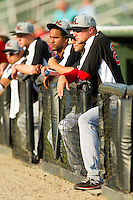 Hickory Crawdads manager Corey Ragsdale (right) watches the action from the top step of the dugout during the South Atlantic League game against the Kannapolis Intimidators at CMC-Northeast Stadium on July 28, 2013 in Kannapolis, North Carolina.  The Crawdads defeated the Intimidators 6-1.  (Brian Westerholt/Four Seam Images)