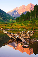 Sunrise on the North and South Maroon Peaks reflected in Maroon Lake at the Maroon Bells Scenic Area.