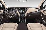 Stock photo of straight dashboard view of a 2015 Hyundai Grand Santa Fe Executive 5 Door SUV