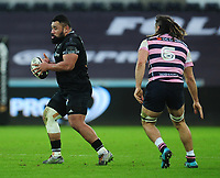 Ospreys' Ma&rsquo;afu Fia under pressure from Cardiff Blues&rsquo; Josh Navidi<br /> <br /> Photographer Kevin Barnes/CameraSport<br /> <br /> Guinness Pro14 Round 13 - Ospreys v Cardiff Blues - Saturday 6th January 2018 - Liberty Stadium - Swansea<br /> <br /> World Copyright &copy; 2018 CameraSport. All rights reserved. 43 Linden Ave. Countesthorpe. Leicester. England. LE8 5PG - Tel: +44 (0) 116 277 4147 - admin@camerasport.com - www.camerasport.com