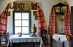 Stock photo of an Ancient Ukrainian country house kitchen interior decorated with Ukrainian folk patterns and icons Eastern Europe Ukraine Pirogovo Ukrainian national folk art museum near Kiev Horizontal 2007