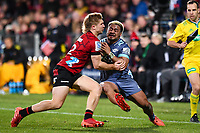 25th July 2020, Christchurch, New Zealand;  Asafo Aumua of the Hurricanes fends off Jack Goodhue of the Crusaders during the Super Rugby Aotearoa, Crusaders versus Hurricanes at Orangetheory stadium, Christchurch