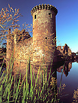 Medieval Scottish castle Caerlaverock Castle catching the summer evening sunshine near Dumfries Scotland UK
