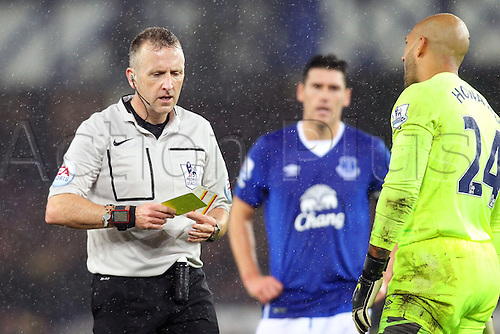 19.12.2015. Goodison Park, Liverpool, England. Barclays Premier League. Everton versus Leicester City. Tim Howard of Everton is cautioned and shown the yellow card for his foul on Jamie Vardy of Leicester City in the penalty area