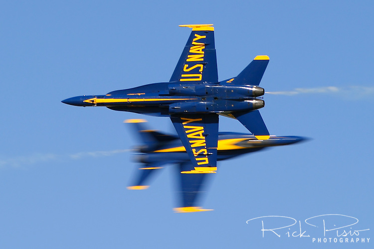The United States Navy Blue Angel's Lead Solo and Opposing Solo pass each other at show center during the 2004 Lemoore Naval Air Station Airshow. With a closure rate of nearly 1200 mph split second accuracy and precision is required by the pilots in order to cross at the pre-determined point on the flight line. Photographed 03/04