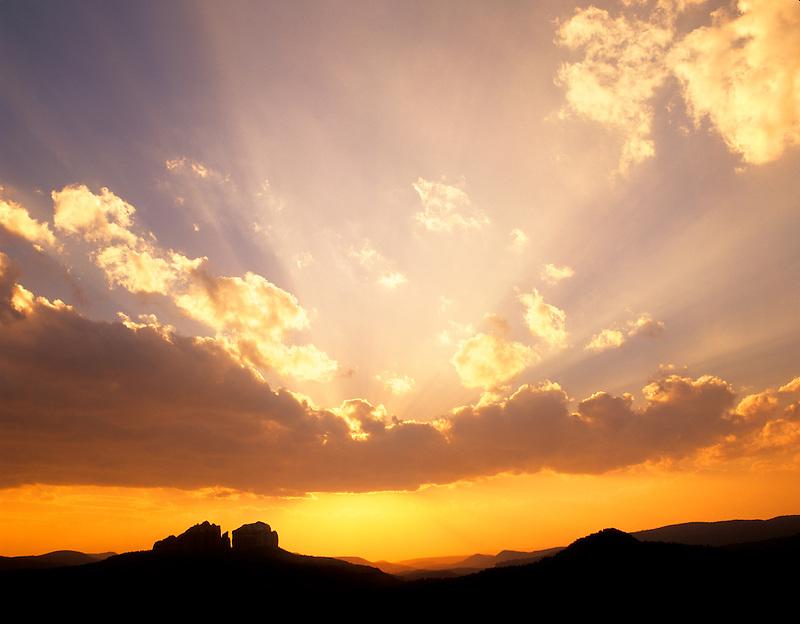 Sunset clouds with sun rays. Near Sedona, Arizona.
