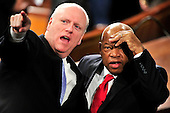 United States Representative Joseph Crowley (Democrat of New York), left, points out a guest in the gallery to U.S. Representative John Lewis (Democrat of Georgia), right, as they await the arrival of U.S. President Barack Obama to deliver his first State of the Union Address in the Chamber of the U.S. House of Representatives in the U.S. Capitol in Washington, D.C. on Wednesday, January 27, 2010..Credit: Ron Sachs / CNP.(RESTRICTION: NO New York or New Jersey Newspapers or newspapers within a 75 mile radius of New York City)