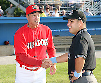 Batavia Muckdogs manager Dann Bilardello (11) and umpire Tom McAdoo during a game vs. the Auburn Doubledays at Dwyer Stadium in Batavia, New York June 19, 2010.   Batavia defeated Auburn 2-1.  Photo By Mike Janes/Four Seam Images