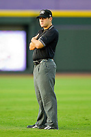 Umpire Rich Gonzalez handles the calls on the bases during the Carolina League game between the Potomac Nationals and the Winston-Salem Dash at BB&T Ballpark on June 13, 2012 in Winston-Salem, North Carolina.  The Dash defeated the Nationals 5-3.  (Brian Westerholt/Four Seam Images)