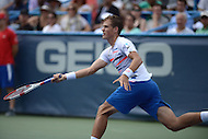 Washington, DC - August 3, 2014: Vasek Pospisil of Canada returns the ball to fellow Canadian Milos Raonic in the Citi Open final, August 3, 2014. Raonic won in straight sets over Pospisil.   (Photo by Don Baxter/Media Images International)
