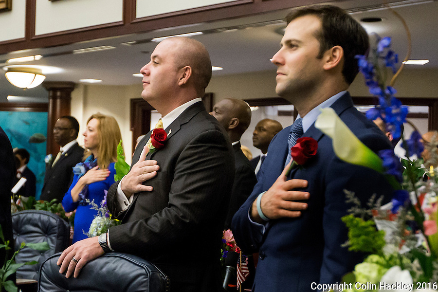 TALLAHASSEE, FLA. 1/12/16- Reps. Blaise Ingoglia, R-Spring Hill, left, and Chris Sprowls, R-Palm Harbor, stand as the National Anthem is sung during the opening day of the 2016 legislative session, Tuesday at the Capitol in Tallahassee.<br /> <br /> COLIN HACKLEY PHOTO