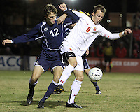 Jason Herrick #9 of the University of Maryland shields the ball from Andy Parr #12 of Penn State during an NCAA 3rd. round match at Ludwig Field, University of Maryland, College Park, Maryland on November 28 2010.Maryland won 1-0.