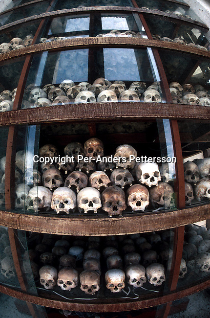 Human skulls are displayed at Choeung-Ek (killing fields), a memorial for victims of the Kmer Rouge regime on March 10, 1998 outside Phnom Penh, Cambodia. The country is still trying to recover from the Kmer Rouge occupation, and the atrocities that has affected most families in the country. .Photo: Per-Anders Pettersson/ iAfrika Photos