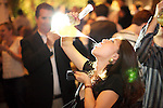 NEW YORK, NY - SEPTEMBER 30, 2013: A partygoer drinks from a traditional Spanish Porron at the after party for the Star Chefs International Culinary Congress at Toro in the Meat Packing District. CREDIT: Clay Williams for Star Chefs.<br /> <br /> &copy; Clay Williams / http://claywilliamsphoto.com