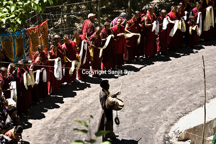 """Monks gather to be blessed outside the Hemis Monastery by His Holiness the Twelfth Gyalwang Drukpa, the head of the Drukpa Lineage. His Holiness finished his, """"Walking On The World's Rooftop"""" Pad Yatra (walk) from Manali to Ladakh. The culmination of the Pad Yatra coincides with the colourful age-old Hemis festival in Leh, Ladakh, India."""