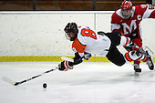 Birmingham Brother Rice defenseman Andrew Roye (8) gets tripped up going for the puck with Stephan Beauvais (background), Orchard Lake St. Mary's, during hockey action at the Oak Park Ice Arena Wednesday, Nov. 30, 2011.