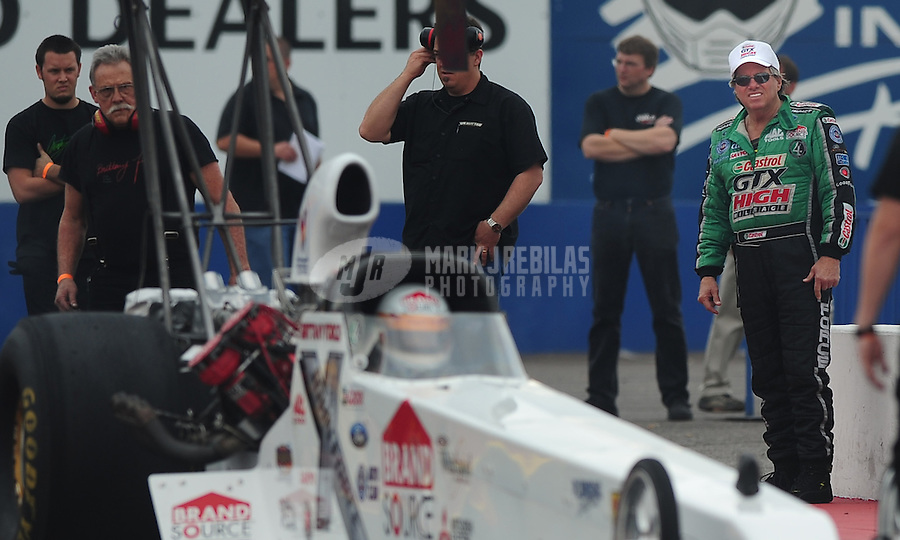 Jan 23, 2009; Chandler, AZ, USA; NHRA funny car driver John Force (right) looks on as daughter Brittany Force races during testing at the National Time Trials at Firebird International Raceway. Mandatory Credit: Mark J. Rebilas-