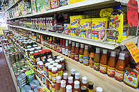 Indo-Caribbean products mixed in with domestic products in a grocery in Richmond Hill in the New York borough of Queens on Thursday, June 25, 2015. The neighborhood of Richmond Hill is a polyglot of ethnic cultures. It is home to Pakistanis, Indians, Guyanese and has a large Sikh population.  (© Richard B. Levine)