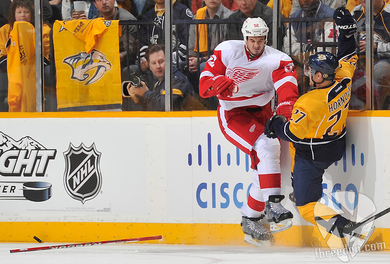 NASHVILLE, TN - APRIL 11: Jonathan Ericsson #52 of the Detroit Red Wings checks Patric Hornqvist #27 of the Nashville Predators off the puck in Game One of the Western Conference Quarterfinals during the 2012 NHL Stanley Cup Playoffs at the Bridgestone Arena on April 11, 2012 in Nashville, Tennessee. (Photo by John Russell/NHLI via Getty Images) *** Local Caption *** Jonathan Ericsson;Patric Hornqvist