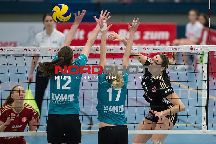 19.01.2014, Halle Berg Fidel, Muenster<br /> Volleyball, Bundesliga Frauen, USC M&uuml;nster / Muenster vs. SC Potsdam<br /> <br /> Block / Doppelblock Wiebke Silge (#12 USC Muenster), Ines Bathen (#17 USC Muenster) - Angriff Marie-Pier Murray Methot (#17 Potsdam)<br /> <br />   Foto &copy; nordphoto / Kurth