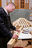 Student on Construction course working with model of timber roof Barnet College North London