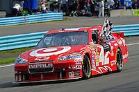 6-8 August, 2010, Watkins Glen, New York USA.Winner Juan Pablo Montoya (#42) with the checkered flag..©2010 F.Peirce Williams, USA.