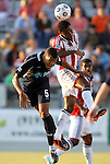 05 June 2012: Chivas USA's James Riley (right) heads the ball over Carolina's Amir Lowery (5). The Carolina RailHawks (NASL) lost 1-2 to Club Deportivo Chivas USA (MLS) at WakeMed Soccer Stadium in Cary, NC in a 2012 Lamar Hunt U.S. Open Cup fourth round game.