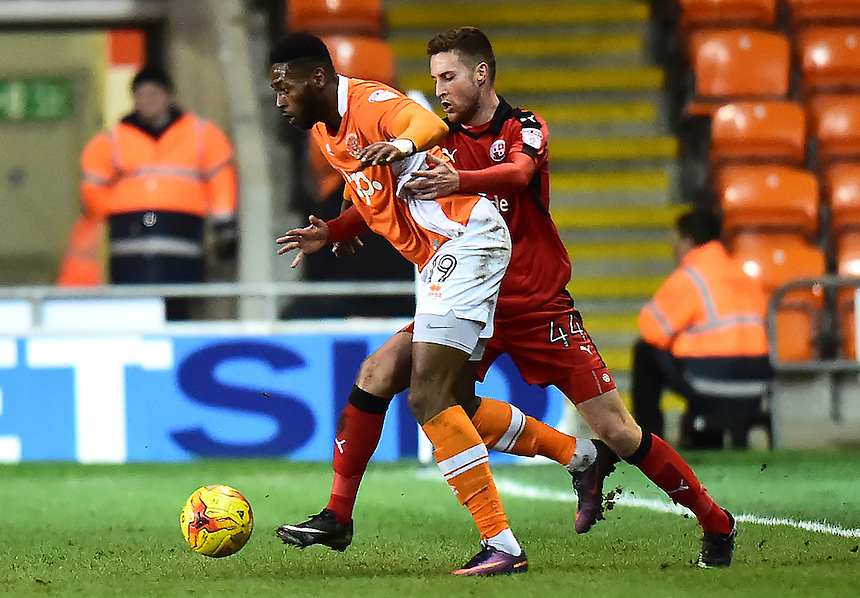 Blackpool's Jamille Matt vies for possession with Crawley Town's Conor Henderson<br /> <br /> Photographer Richard Martin-Roberts/CameraSport<br /> <br /> The EFL Sky Bet League Two - Blackpool v Crawley Town - Tuesday 7th February 2017 - Bloomfield Road - Blackpool<br /> <br /> World Copyright &copy; 2017 CameraSport. All rights reserved. 43 Linden Ave. Countesthorpe. Leicester. England. LE8 5PG - Tel: +44 (0) 116 277 4147 - admin@camerasport.com - www.camerasport.com