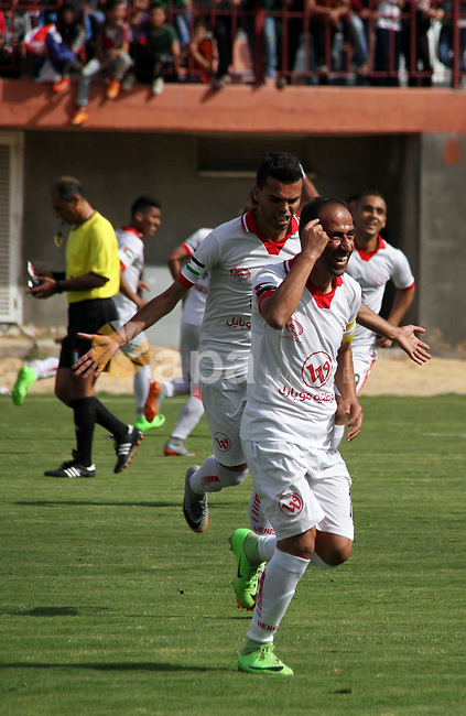 Palestinian players of Shabab Khan Younis football club celebrate after scoring a goal during the final football match of the Palestine Cup for the southern governorates with Shabab Rafah football club at Palestine stadium in Gaza city on April 30, 2018. Photo by Mahmoud Ajour