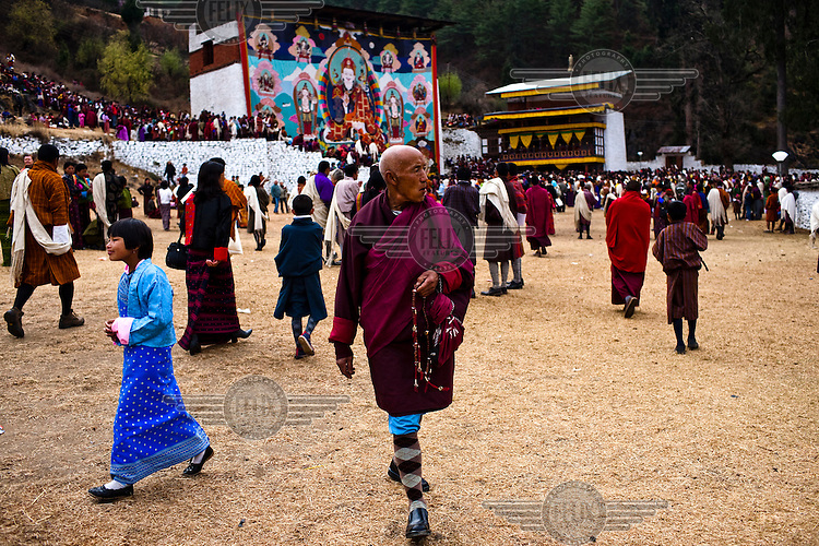 Local Bhutanese gather to witness an ancient and giant thangka, a silk painting with embroidery, being unveiled during a festival in Paro Dzong in Paro, Bhutan.