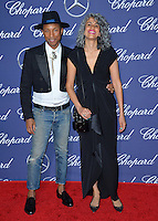 Singer/producer Pharrell Williams &amp; producer Mimi Valdes at the 2017 Palm Springs Film Festival Awards Gala. January 2, 2017<br /> Picture: Paul Smith/Featureflash/SilverHub 0208 004 5359/ 07711 972644 Editors@silverhubmedia.com