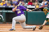 LSU Tigers first baseman Chris Chinea (26) follows through on his swing during the NCAA baseball game against the Baylor Bears on March 7, 2015 in the Houston College Classic at Minute Maid Park in Houston, Texas. LSU defeated Baylor 2-0. (Andrew Woolley/Four Seam Images)