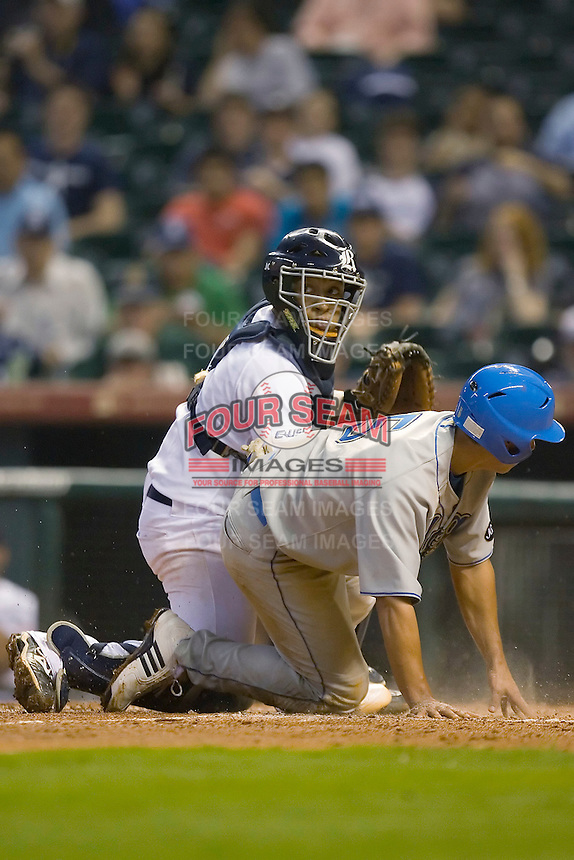 Tyler Rahmatulla #5 of the UCLA Bruins is tagged out at home plate by Diego Seastrunk #5 of the Rice Owls in the 2009 Houston College Classic at Minute Maid Park February 27, 2009 in Houston, TX.  The Owls defeated the Bruins 5-4 in 10 innings. (Photo by Brian Westerholt / Four Seam Images)