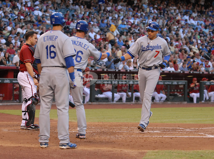 Jun 26, 2007; Phoenix, AZ, USA; Los Angeles Dodgers first baseman (7) James Loney is congratulated after hitting a two run home run in the second inning against the Arizona Diamondbacks at Chase Field. Mandatory Credit: Mark J. Rebilas-US PRESSWIRE Copyright © 2007 Mark J. Rebilas