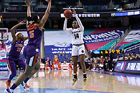 GREENSBORO, NC - MARCH 6: Marnelle Garraud #14 of Boston College shoots over Amari Robinson #5 of Clemson University during a game between Clemson and Boston College at Greensboro Coliseum on March 6, 2020 in Greensboro, North Carolina.