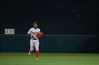 Mesa Solar Sox center fielder Victor Robles (14), of the Washington Nationals organization, jogs off the field between innings of an Arizona Fall League game against the Scottsdale Scorpions on October 23, 2017 at Scottsdale Stadium in Scottsdale, Arizona. The Solar Sox defeated the Scorpions 5-2. (Zachary Lucy/Four Seam Images)