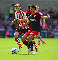 Lincoln City's Michael O'Connor vies for possession with Swindon Town's Steven Alzate<br /> <br /> Photographer Andrew Vaughan/CameraSport<br /> <br /> The EFL Sky Bet League Two - Lincoln City v Swindon Town - Saturday August 11th 2018 - Sincil Bank - Lincoln<br /> <br /> World Copyright &copy; 2018 CameraSport. All rights reserved. 43 Linden Ave. Countesthorpe. Leicester. England. LE8 5PG - Tel: +44 (0) 116 277 4147 - admin@camerasport.com - www.camerasport.com