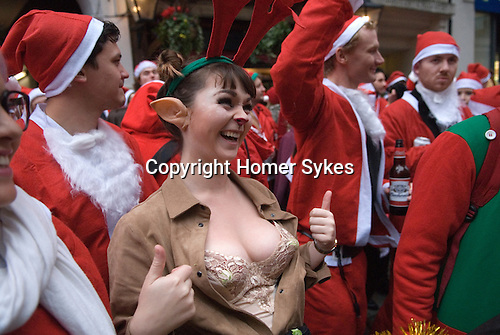 One of Santas Elfs. SantaCon meet up outside Liverpool Street Station central city of London UK 2015.