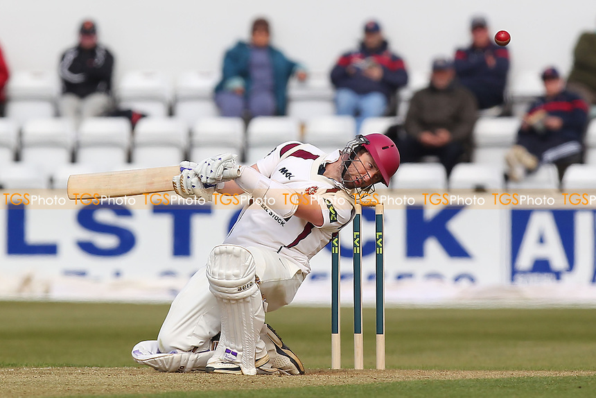 Steven Crook of Northants ducks under a Tymal Mills bouncer - Northamptonshire CCC vs Essex CCC - LV County Championship Division Two Cricket at the County Ground, Northampton - 18/04/13 - MANDATORY CREDIT: Gavin Ellis/TGSPHOTO - Self billing applies where appropriate - 0845 094 6026 - contact@tgsphoto.co.uk - NO UNPAID USE.