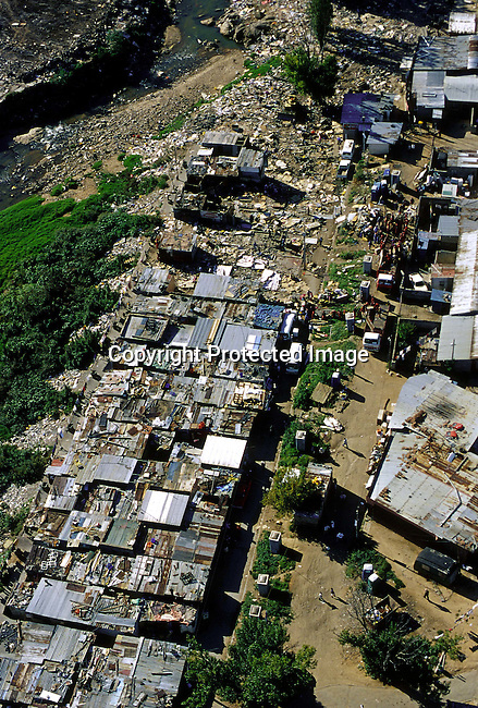 lstoale30014 Township. An overview of Alexandra squatter camp on March 3, 2001 north of Johannesburg, South Africa..Alexandra is one of the poorest townships in South Africa, where poverty, violence, unemployment and a growing HIV/Aids epidemic is keeping the people from leaving he poverty trap. Thousands of illegal squatters were evicted and their shacks and belongings were destroyed by the Johannesburg local government in February-2000..Photo: Per-Anders Pettersson/ iAfrika Photos