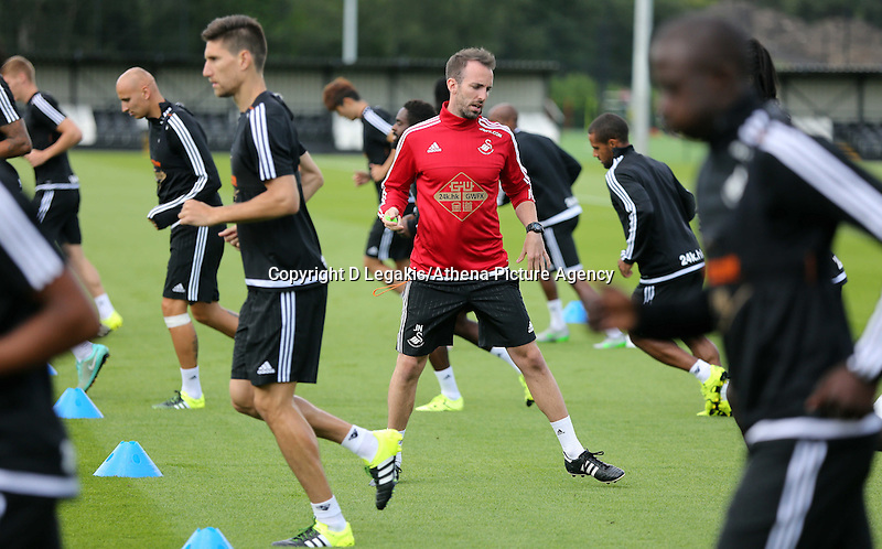 Thursday 09 July 2015<br /> Pictured: Jonny Northeast putting the players through their paces during training<br /> Re: Swansea City FC pre-season training at Landore training ground, Swansea, south Wales, UK.