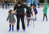 NWA Democrat-Gazette/ANDY SHUPE<br /> Carrie McInturff (center) of Pea Ridge skates Saturday, Nov. 21, 2015, with her 4-year-old daughter, Emlyn, during the first day of skating at the Lawrence Plaza skating rink in Bentonville. The rink is beginning its sixth year and is open daily through mid-January. Visit nwadg.com/photos to see more from the opening day.