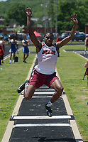 NWA Democrat-Gazette/ANDY SHUPE<br /> Brendyn Harris of Beebe leaps Wednesday, May 15, 2019, while competing in the long jump portion of the state decathlon championship at Ramay Junior High School. Visit nwadg.com/photos to see more photographs from the meet.