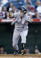 Brent Abernathy of the Tampa Bay Devil Rays bats during a 2002 MLB season game against the Los Angeles Angels at Angel Stadium, in Los Angeles, California. (Larry Goren/Four Seam Images)