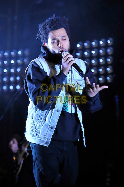 Abel Tesfaye aka The Weeknd .performing at the Barclaycard Wireless Festival, Hyde Park, London, England. 7th July 2012..music live gig on stage show half length microphone singing denim sleeveless black jacket gilet .CAP/MAR.© Martin Harris/Capital Pictures.