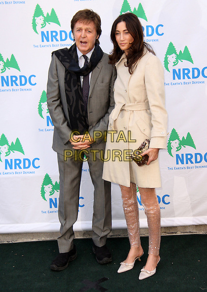 "SIR PAUL McCARTNEY & NANCY SHEVELL.Natural Resources Defense Council 11th Annual ""Forces For Nature"" Benefit held at 583 Park Avenue, New York, NY, USA..March 30th, 2009.full length grey gray black scarf suit couple cream mac clutch bag sequins sequined trousers .CAP/ADM/PZ.©Paul Zimmerman/AdMedia/Capital Pictures."