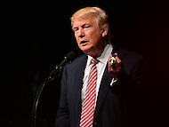 Ashburn, VA - August 2, 2016: Republican presidential candidate and businessman Donald J. Trump holds a Purple Heart medal during a campaign event in Ashburn, VA, August 2, 2016. Trump said the medal was given to him by a veteran who supported him and his campaign. (Photo by Don Baxter/Media Images International)