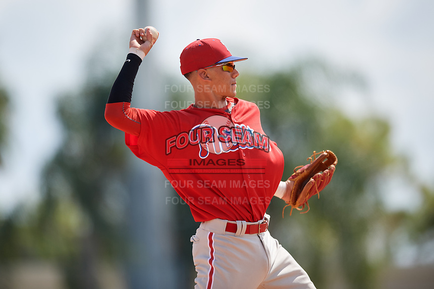 Philadelphia Phillies Juan Herrera (22) throws to first base during a Florida Instructional League game against the Baltimore Orioles on October 4, 2018 at Ed Smith Stadium in Sarasota, Florida.  (Mike Janes/Four Seam Images)