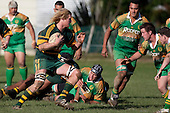 Jamie Chipman lines up Nathan Pyne & Robert Dunning  as he takes the ball forward. Counties Manukau Premier Club rugby game between Drury & Pukekohe played at the Drury Domain on Saturday May 23rd 2009..Pukekohe won the game 23 - 11 after laeding 16 - 11 at halftime.